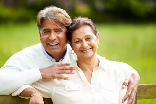 an older couple smiles | Dental Implants Humble TX