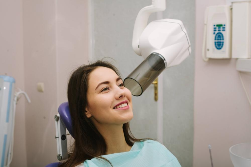 a woman gets a dental x-ray | dentist in humble