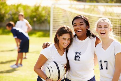 friends smile in front of a soccer goal | Preventive dentist in humble tx