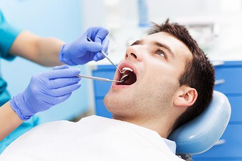 a man gets his teeth worked on | Humble TX gum disease treatment