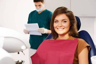 a woman smiles in the dental chair | periodontal treatment Humble, TX