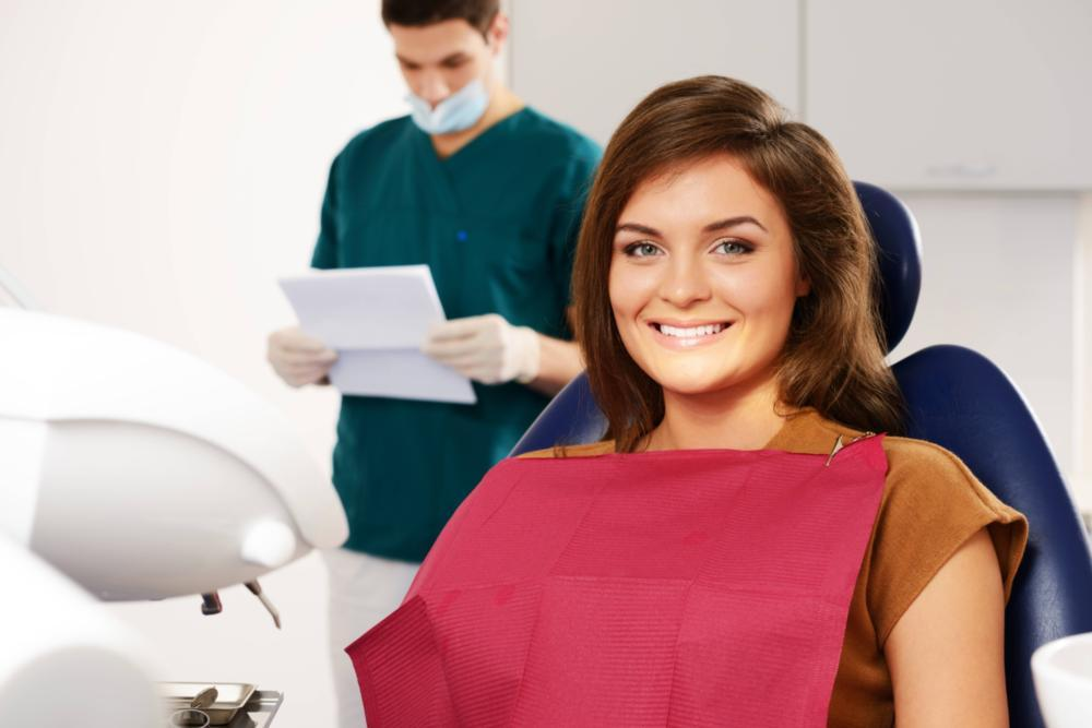 A woman smiles in the dental chair | Humble TX Dentist