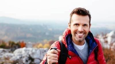man smiling on a hike