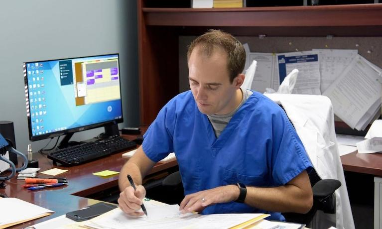 dr. robert appel working on some forms | dentist in humble tx